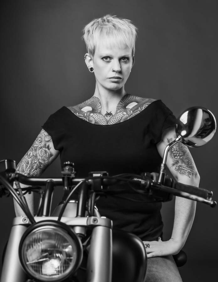 woman on motorbike portrait