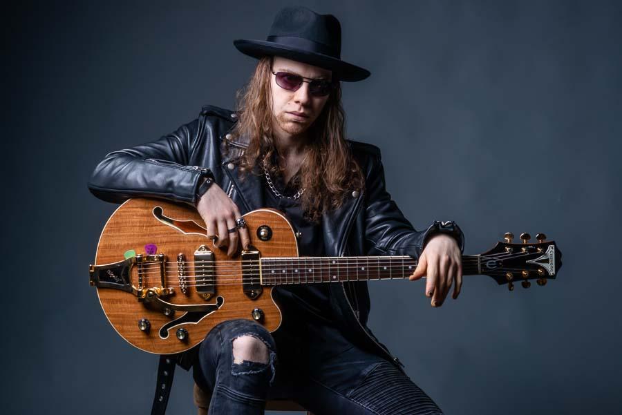 musician with guitar portrait